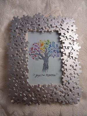 Рамка для фото декорированная пазлами